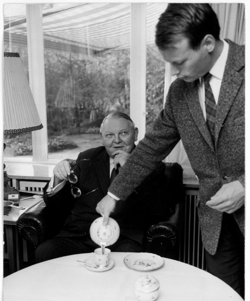 My dad pouring tea for his uncle, the chancellor, in the 60s